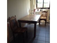 Solid Wooden Dining Table and six chairs. Very Good Condition