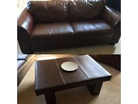 Leather couch and matching coffee table