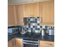 Oak colour kitchen for sale sink, NEF job and oven, top & bottom cupboards. Plus extractor hood
