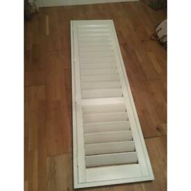 Plantation shutter and z frame faux wood white