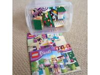 Big box of pink Lego and five friends Lego sets with instructions