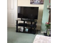 Black glass tv unit as new