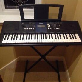 Yamaha digital keyboard. PSR E333 YPT 330. With stand.
