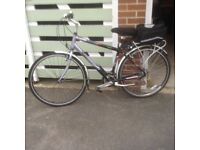 Raleigh pioneer metro GX . Mint condition . Garaged and used no more than 5 times