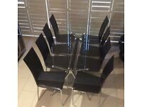 Good quality glass dining room table with 8 chairs