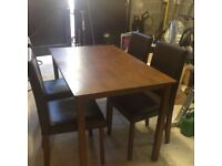 Walnut table and four Faux leather chairs