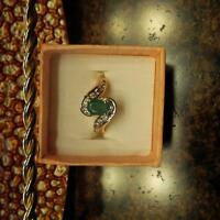 14k gold emerald and diamond ring.