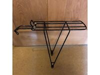 Bike pannier rack in perfect condition. Easy to adjust to many bike sizes.