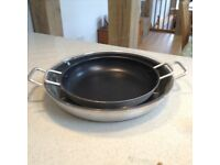 2 x two handled paella pans both as new.