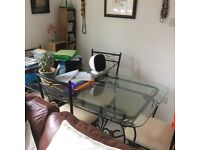 Table and five chairs. Glass top table, one chair still in box. Very good condition.