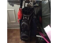 Golf clubs,golf bag and electric trolley.