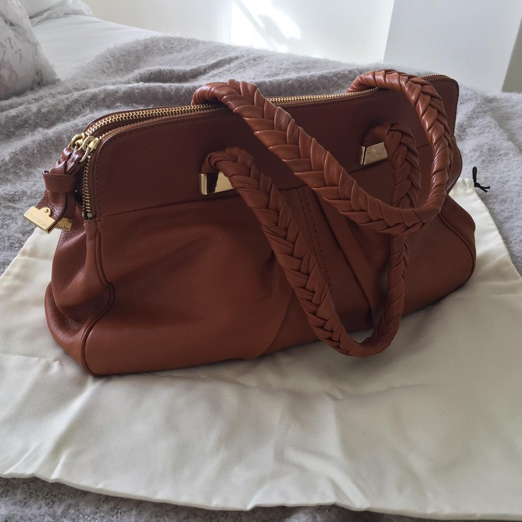 Antonio Melani Bagin Bicester, OxfordshireGumtree - Antonio Melani Leather Tan Handbag Immaculate condition Hardly used Comes with Dust bag Very soft leather Lots of hardy compartments Magnetic clasp(PLEASE TEXT ONLY DO NOT WANT CALLS OR EMAILS)