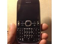 Nokia asha 302 on 3 network looks new silver and black
