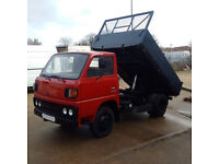 Left hand drive Mitsubishi Canter FE110 2.7 diesel 6 tyres 3 way tipper. Steel body.