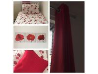 Red bedroom bedding/curtains/ pictures and cushion.