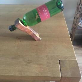 Magical floating bottle holder