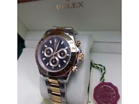 Mens twotone Rolex Daytona with black face and gold bezel with all twotone oyster bracelet.