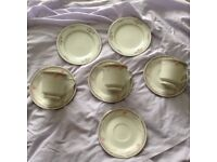 3 Cups, 4 Saucers and 2 Side Plates from the Fine Quality Porcelain Foreign Set