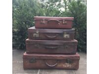 4 Vintage leather suitcases