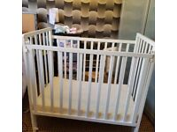 Saplings space saving baby cot