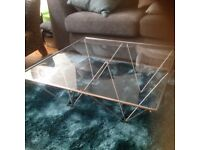 Glass and stainless steel coffee table