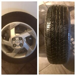 4 All Season Dunlop Signature Tires with Rims