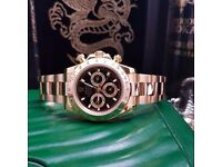 Gold rolex Daytona with black face comes complete with bag box and papers