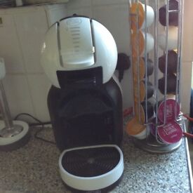 Dolce gusto coffee machine and some pods and pod keeper