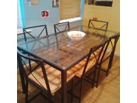 Ikea glass/metal dining table with 6 chairs +4 extra free chairs