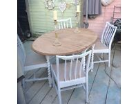 Solid oak barley twist gate leg table and 4 chairs