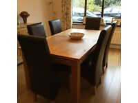 Solid oak dining table with 8 real leather dining chairs