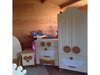 Kids solid wood bedroom furniture and bed.