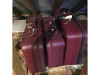 Maroon Suitcases