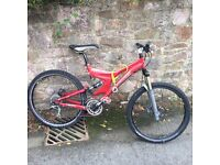 Specialized Enduro full suspension bike, red.