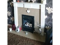 White fire surround with marble hearth and back.