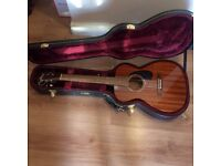 Guild M-120E mahogany used right handed 6 string electro-acoustic guitar