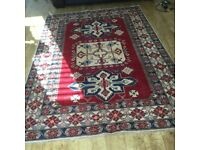 A BEAUTIFUL KAZAK 100% WOOL RUG MADE IN PAKISTAN. MAIN COLOUR RED. A LUXURIOUS STUNNING RUG.