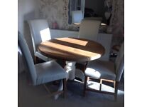 Solid pine table with four cream high back chairs