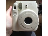 White Fujifilm Polaroid Camera