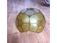 Shell effect lamp shade yellow white and orange.
