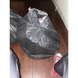 Black bag full of girls clothes