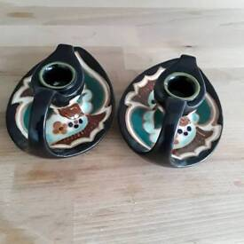 2 old Japanese pottery candle holders .