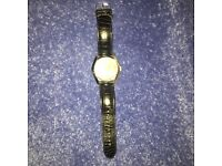 Black leather armani watch. Slight wear and tear. Rrp £120 willing to accept £50