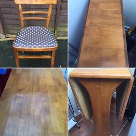 Wooden Dining room table and Four chairs