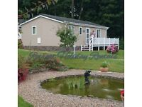 Short breaks available at our luxury 2 bed lodge Woodlands Park , New Quay Wales