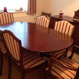EXTENDING DINING TABLE WITH FOUR CHAIRS AND TWO CARVERS BY WILLIAM BARTLETT