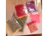 Various favour bags in different colours pink blue patterned