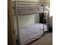 ALMOST NEW METAL BUNK BED WITH MATTRESSES