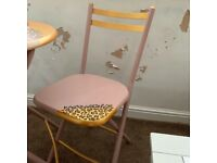 Leopard print table and chairs