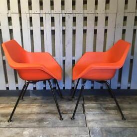 Vintage retro pair of Pel orange chairs